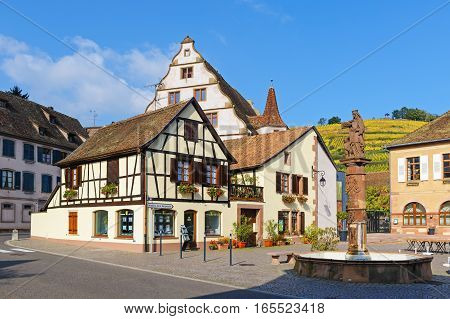 ANDLAU, ALSACE / FRANCE - OCTOBER 19, 2015: Central square of the small town in autumn. Andlau has been a wine-growing centre and traveler destination since its earliest days.