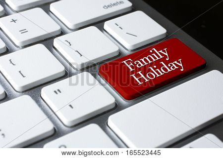 Travel concept: Family Holiday on white keyboard