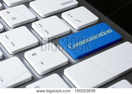 Communication word on blue enter computer keyboard
