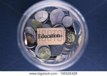 Saving Concept : Education label with coins in the glass