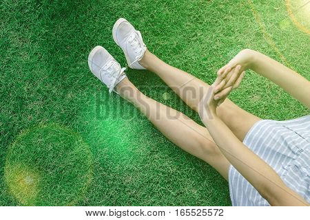 Woman Stretching Relaxation with white canvas on green grass