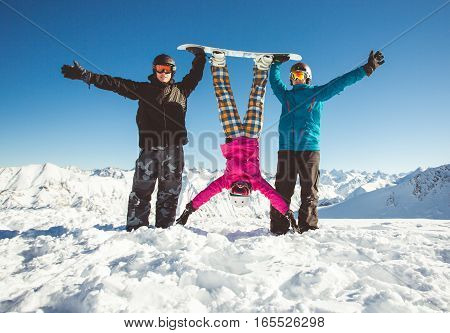 Snowboarders in colorful jackets have fun in the alpine mountains. snowboarding concept.