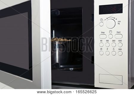 a microwave oven with an open door