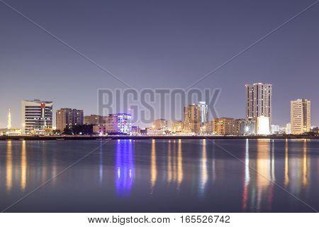 Ras al Khaimah skyline reflecting in the creek. United Arab Emirates Middle East