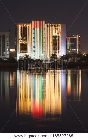 RAS AL KHAIMAH UAE - NOV 30 2016: Headquarters of the RAK GAS company illuminated at night. Ras al Khaimah United Arab Emirates Middle East