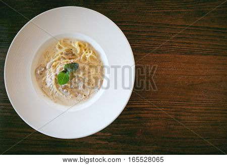 Close up of Spaghetti cream sauce tuna and mushroom in soft vintage tone and copyspace