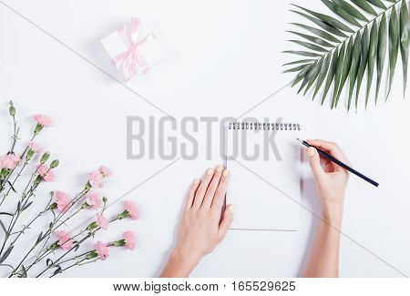 Female Hand Writing In A Notebook At The Desk, Top View