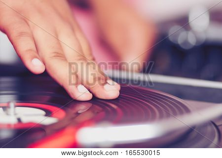 Hand Of Dj Scratch Vinyl Record On Turntable