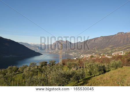An suggestive view of Lake Iseo at sunset with the fog - Lombardy - Italy