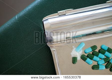 close up opened medicine capsule pill with powder
