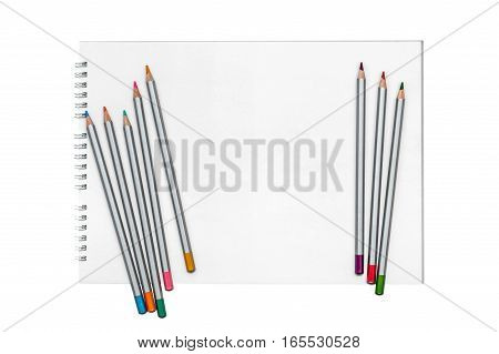 Multicolored pencils on the album for drawing isolated on white