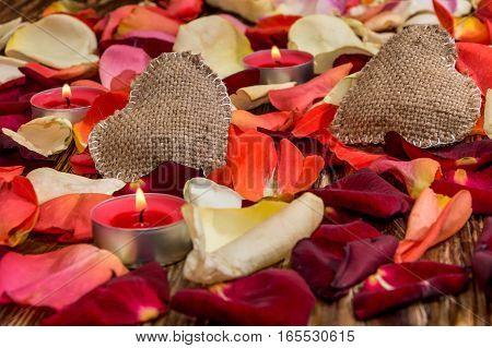 Stylized sackcloth heart with petals of roses.