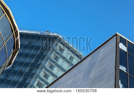Element of modern building. The glass facade of the winter in front of a blue sky. Architectural background
