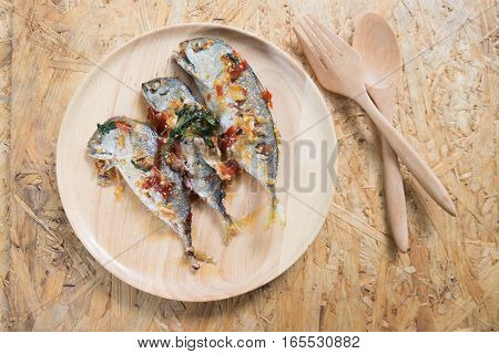 Mackerel served with chilli sauce in Thai menu food food style on the wood table