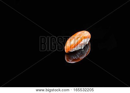 classic sushi with salmon on black background
