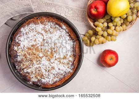 Cheesecake With Vintage Knife And Fresh Fruits On Light Marble Background