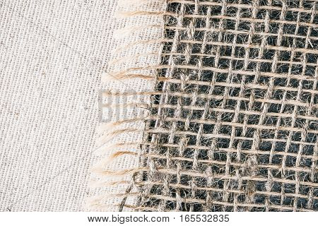 Combined background of unbleached linen fabric and sackcloth. Macro view