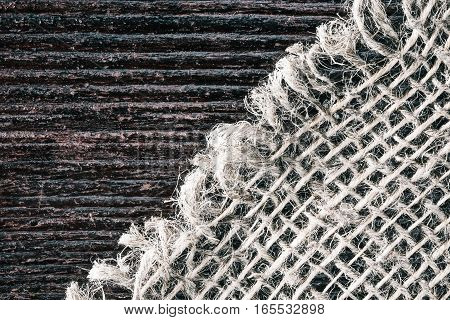 Combined background of sackcloth and dark wood. Macro view