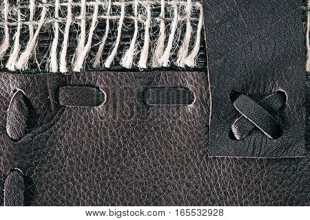 Combined background of brown stitched leather and sackcloth. Macro view