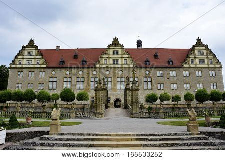 The ornate Weikersheim Palace in Germany on a cloudy day
