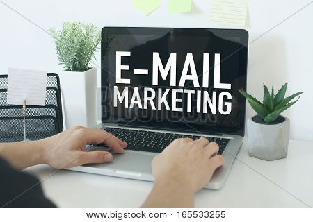 E-mail marketing business concept with businessman in office