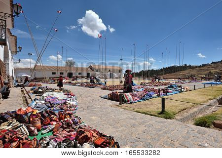 CHINCHERO PERU - September 01 2016: Unidentified people trades traditional souvenirs in Chinchero Peru on September 01 2016. Chinchero is a small Andean Indian village located 30km from Cusco