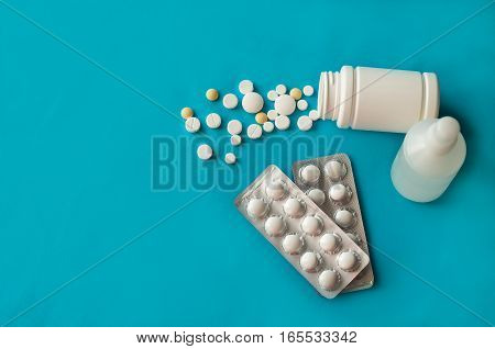 Medicine pills white on a blue background, top view