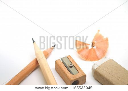 Education tool Pencil Scrap Eraser and Sharpener made of wood on white background with copy space
