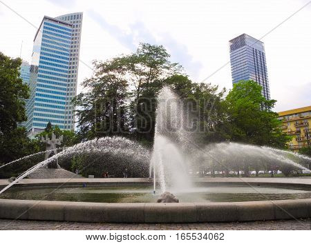 Fountain and skyscrapers in the center of Warsaw Poland.