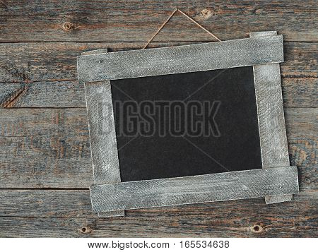 Old wooden frame hanging on the wall