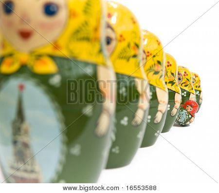 Russian dolls with one standing out from the crowd