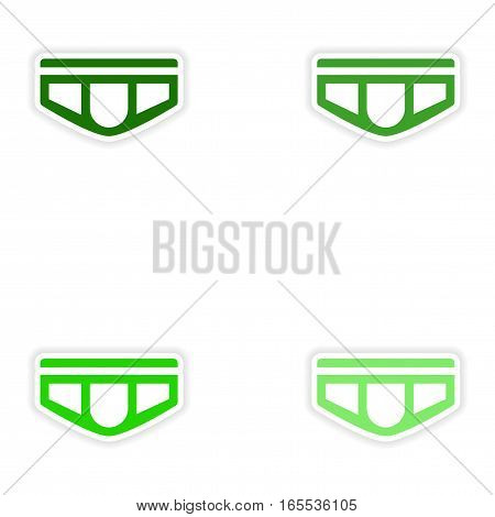 concept stylish paper sticker on white background men's shorts