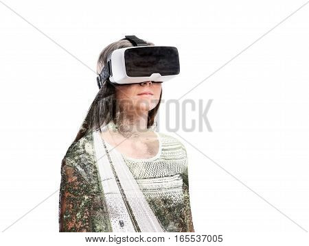 Double exposure. Beautiful woman wearing virtual reality goggles. Highway going through nature. Isolated.