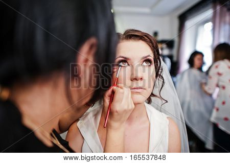 Stylist Makes Make Up Bride On The Wedding Day At Beaty Salon.