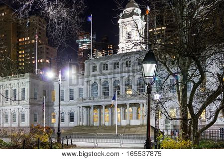 NYC City Hall building with lights at nighttime in Lower Manhattan New York City