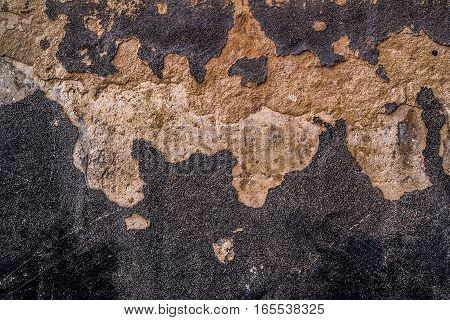 Grunge wall texture, plaster and paint on a concrete wall, plaster texture, bumpy wall, background stucco wall