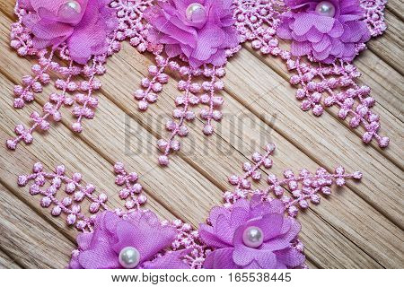 Floral Lace On A Wooden Background With Copy Space. Suitable As A Wedding Invitation.