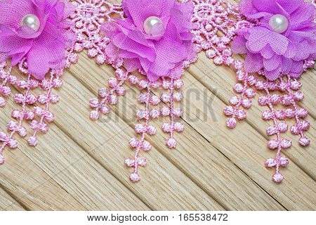 Lace Flowers With Fringe On A Wooden Table. Vintage Floral Background.