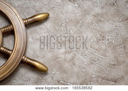Part of the wheel on a beige background with plenty of copy space for your inscription. Top view. Holiday concept.