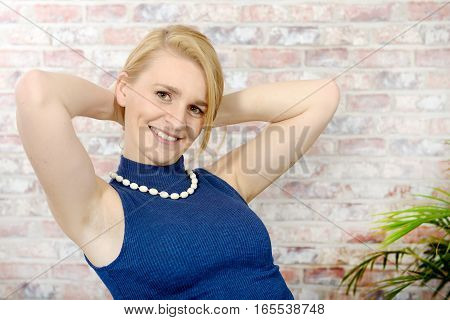 portrait of beautiful blonde woman with a blue sweater