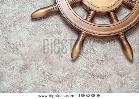 The wheel on a beige background with free space for your writing. Close up top view. Travel vacation concept.