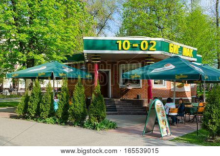 GOMEL BELARUS - MAY 1 2016: Unidentified people are resting outdoors in mini-cafe