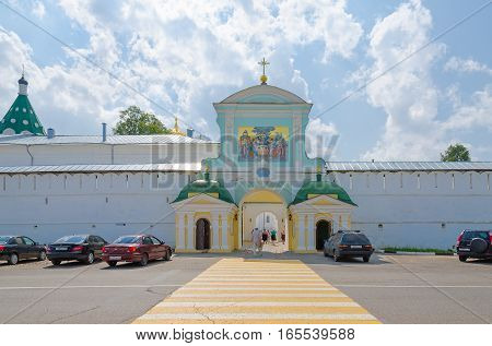 KOSTROMA RUSSIA - JULY 20 2016: Unidentified people enter North (Catherine's) gates of Holy Trinity Ipatyevsky Monastery Kostroma Golden ring of Russia