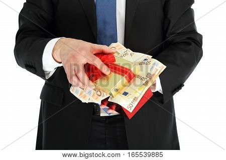 man in suit holding a gift box full of money
