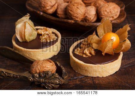 Chocolate Tarts With Walnut And  Physalis