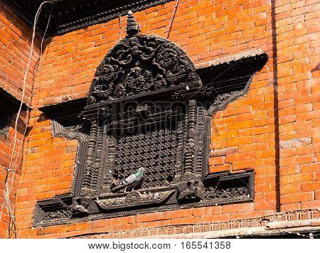 pigeon sitting on a window Kumari Bahal in Kathmandu Durbar Square Nepal