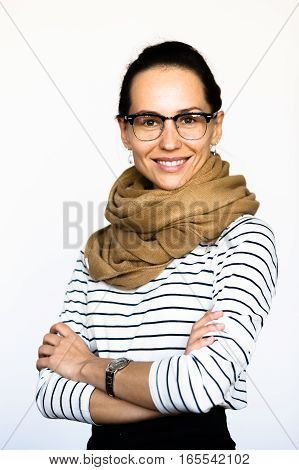 Open wide diaphragm concept. Portrait of businesswoman in glasses in studio. Pretty woman posing with her hands crossed or folded isolated on white background. Studio shot.
