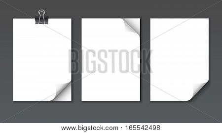 Close up empty paper sheets with curled corner isolated on dark background. Photo realistic paper with paper clip and shadow. Vector stack of papers.