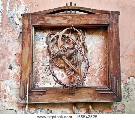 Crown of thorns in vintage frame on old grunge wall