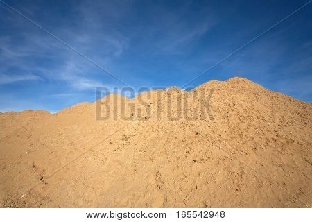 Nature landscape with mountains of sand under a beautiful blue sky